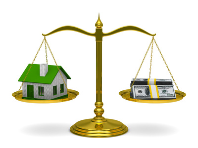 House and money on scales. Isolated 3D image
