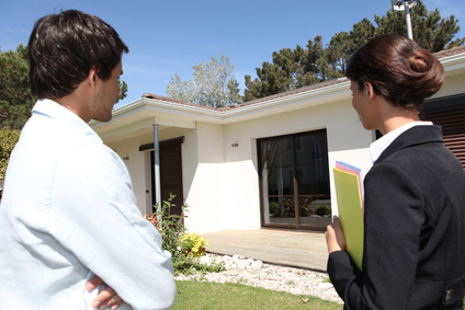 Estate agent about to show customer around property